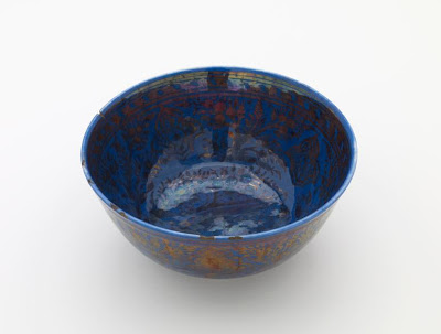 Bowl | Origin:  Iran | Period: 1650-1700  Safavid period | Details:  Not Available | Type: Stone-paste decorated with lustre over darl blue glaze | Size: H: 8.7  W: 18.9   D: 4.1  cm | Museum Code: F1908.115 | Photograph and description taken from Freer and the Sackler (Smithsonian) Museums.