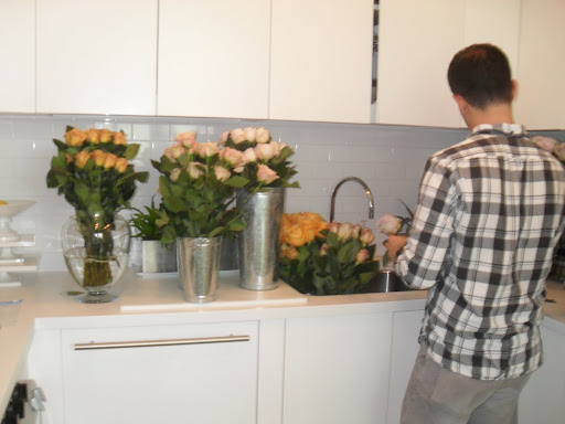 Use as much water as possible for most flowers (like roses) in a vase -- for soft-stem flowers use less water. A tip for tulips: the more water used the more the tulips will droop.