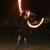 Fire twirling on stilts, Orleigh Park