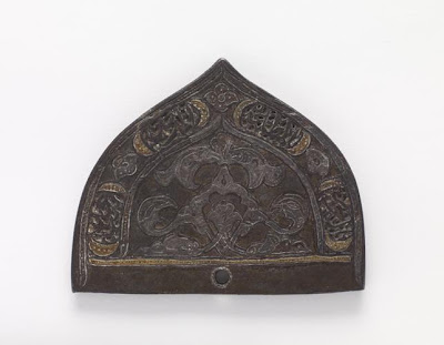 A comb back | Origin:  Iran | Period: 17th century  Safavid period | Details:  Not Available | Type: Iron | Size: H: 6.2  W: 7.7  cm | Museum Code: F1940.4 | Photograph and description taken from Freer and the Sackler (Smithsonian) Museums.