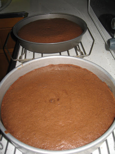 After baking at 350 degrees for approximately 30 minutes, the cakes sat on cooling racks.