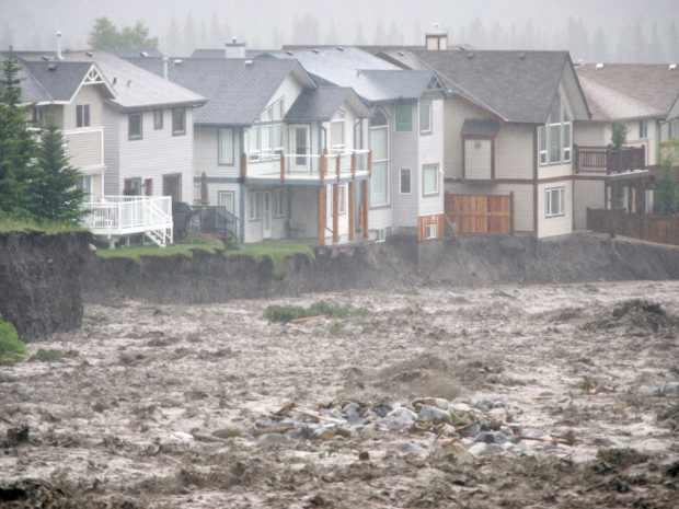 Debris and water pour across the Trans-Canada Highway as Canmore struggles to deal with massive flooding on 20 June 2013. Photo: Craig Douce / Rocky Mountain Outlook