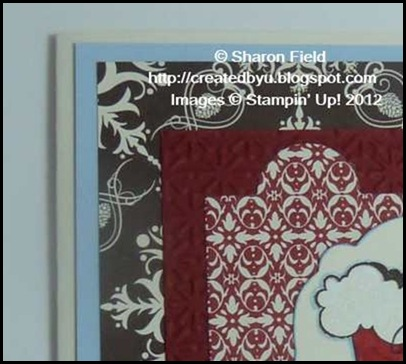 two designer series papers with christmas theme on card