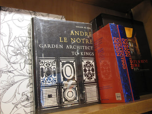The shop has a variety of vintage books. They are displayed around the store, not just in one location.
