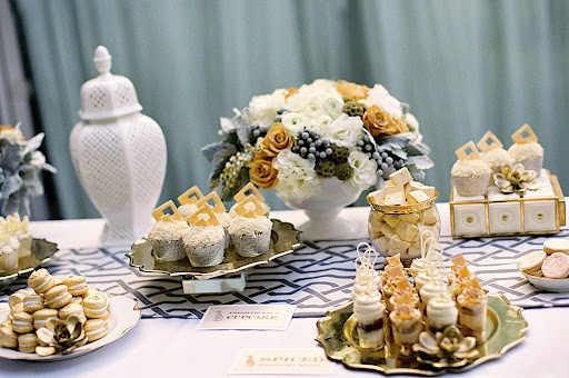 Items in the stunning dessert spread, complete with cupcakes, macarons, homemade marshmallows, and cookies, were adorned with metallic white chocolate or dusted in edible gold.