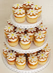 Here I put Elenis sweet daisy cookies (included in the sale) on top of vanilla cupcakes from Butterfly Bakeshop. You can stack your cookie-topped cupcakes on this Martha Stewart Crafts cupcake stand (included in this sale) or put out plates of the treats for your guests to nibble on.