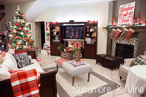 Christmas decorations in a living room for a plaid country Christmas. A truly stunning Christmas Home Tour as part of the Christmas in the Country Blog Tour. This Plaid Inspired Country Christmas will knock your socks off. Features tours of the Living room, Dining Room and a Cocoa hot chocolate bar in the Breakfast room. There is so much inspiration for Christmas decorations in this one post. Be prepared to feel like you are cuddled up by the fire in a warm Northwoods comfy cottage! #country #Christmas #Plaid #Holiday decorating #Holiday ideas #Holidays #Christmas decor #Holiday decor