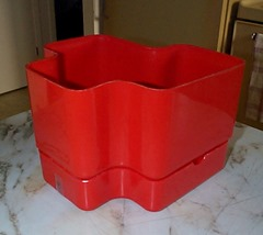 Red plastic planter.   Marked on bottom:  Programma Vastill Modello Vastill Designer Michael McCann A.O.C.A.