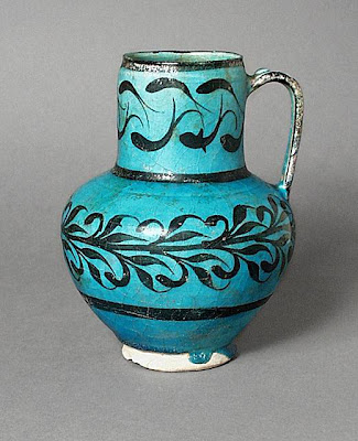 Jug Iran, Kashan Jug, 13th century Ceramic; Vessel, Fritware, underglaze-painted, 7 5/8 x 7 in. (18.7 x 13.6 cm) The Nasli M. Heeramaneck Collection, gift of Joan Palevsky (M.73.5.385) Art of the Middle East: Islamic Department.