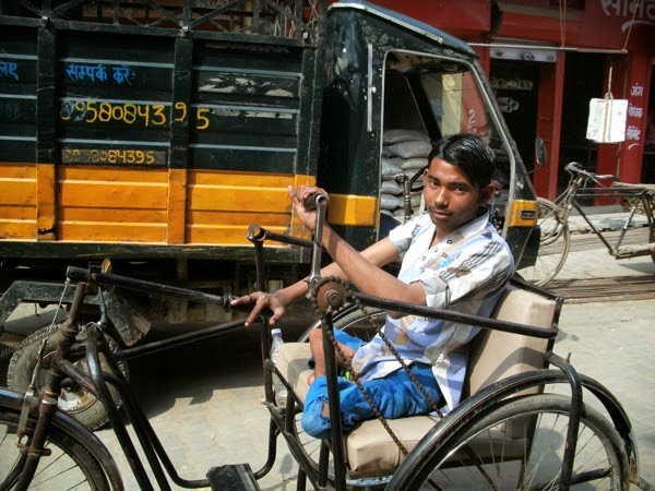 Polio Victim in Tricycle