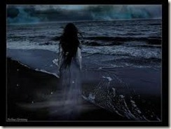 woman at the ocean at night