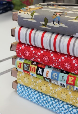 Stack of Sasparilla fabric from Riley Blake