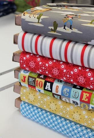 Stack of Sasparilla fabric from Riley Blake