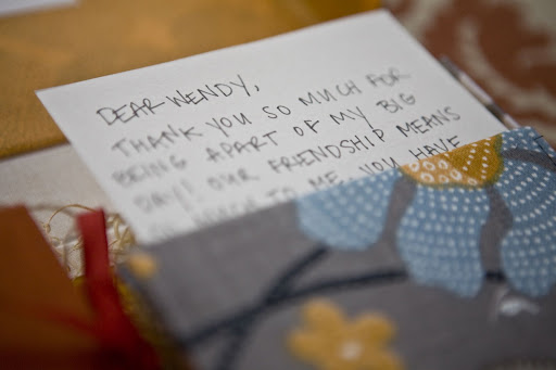 Handwrite a letter and slip it into a patterned fabric envelope to showcase its importance.