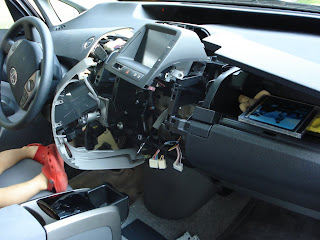 I had to disassemble the dashboard of our new Prius to remove change from the CD player, put there by my little helper Eidan