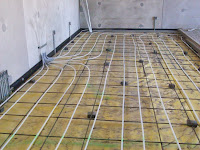 Heated floor under maintenance shop floor
