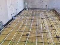 Heated floor under maintenance shop floor