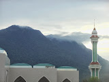 Puncak Erik Samali and Puncak Datuk Panglima Husin in clouds, Gunung Ranai seen in the late afternoon from near the new mosque (Dan Quinn, September 2013)