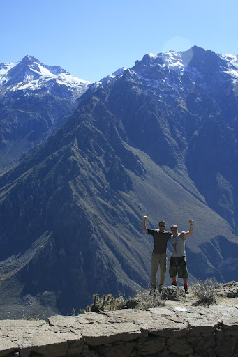Lee and I in the obligatory triumphant pose in front of 6km high mountains.
