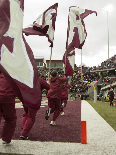"Montana Grizzly Spirit Squad members run the ""GRIZ"" flags after every touchdown.  Washington-Grizzly Stadium in Missoula, Mont., October 27th, 2012."