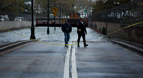 The flooded entrance to the tunnel leading to the Franklin D. Roosevelt Drive in Lower Manhattan after Hurricane Sandy, 30 October 2012. For nearly a decade, scientists told city and state officials that New York faces certain peril: rising sea levels, more frequent flooding, and extreme weather patterns. Damon Winter / The New York Times