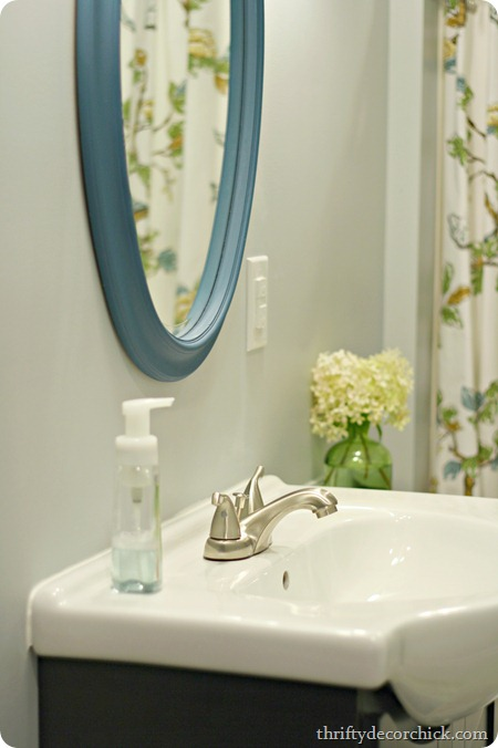 Bright basement bathroom done from thrifty decor chick for Bright bathroom sets