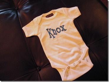 1.  Knox's first onsie