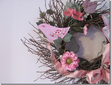 Twig wreath with pink bird.