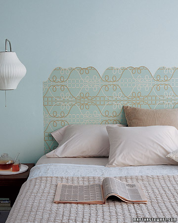 A wallpaper headboard is a more affordable and less bulky option for beds. (marthastewart.com)