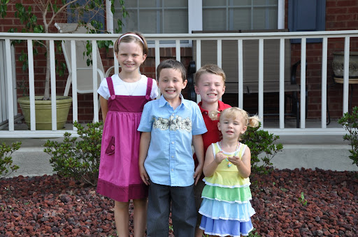 "Natalie, Eli, Ben and Elyse pose for a ""cousin"" picture"