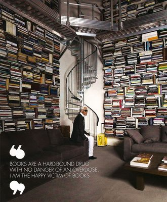 Karl Lagerfeld among his enormous - and enviable - collection of books.