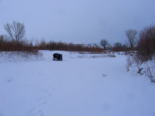 Parked at the north end of the river crossing while I walked out onto the ice to test its thickness