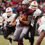 Shay Smithwick-Hann, one of three Montana quarterbacks to play Saturday, takes a quarterback keeper up the middle.  Starter at the position, Smithwick-Hann logged 250 yards and 3 touchdowns on the day.  Washington-Grizzly Stadium in Missoula, Mont., October 27th, 2012.