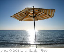 'Beach umbrella in late afternoon sunlight' photo (c) 2006, Loren Sztajer - license: http://creativecommons.org/licenses/by-nd/2.0/