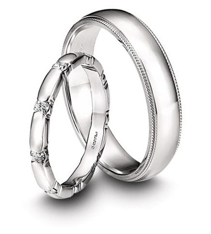 Memoire's Toujours Collection platinum wedding bands feature milligrain edging in the men's band and diamond accents in the women's style. We love that they work together without being too matchy-matchy!