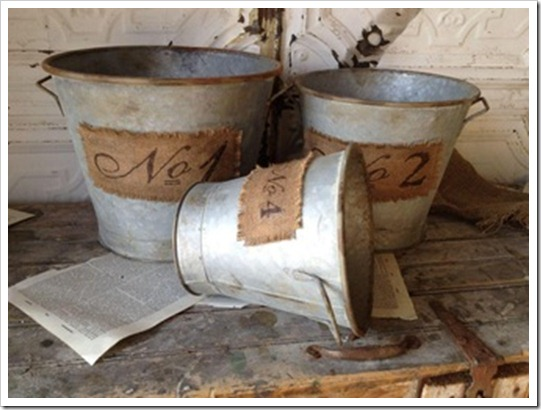 Rusty Metal Bucket with Burlap Patch