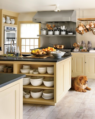 Open shelving allows for easy access to bowls and supplies for an avid chef. (Annie Schlecter/Marthastewart.com)