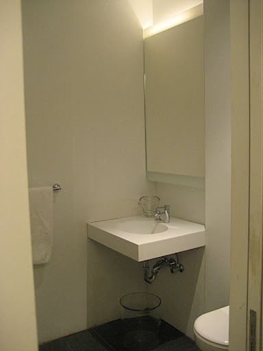 A powder room is located off the main hallway.