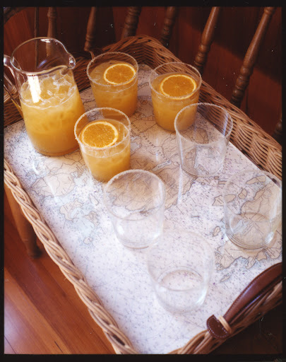 The bottom of this tray was made with inexpensive nautical charts from a boating supply store. (Martha Stewart Living, June 2007)