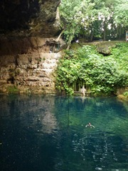 Jenn swimming at Zaci Cenote in Valledolid.  It just disappears into blackness below.