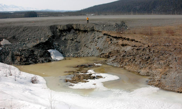NOT SO PERMANENT: A pool of permafrost meltwater has formed along the Alaska Highway near Beaver Creek, Yukon. Guy Dore / Laval University