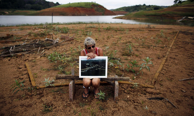 A former resident of the re-emerging old city of the Igarata. The ruins of a sunken town which had remained underwater since 1969 have re-emerged, as parts of Brazil grapple with the country's worst drought in 80 years. Photo: Nacho Doce / Reuters