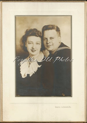 Unknown couple Navy Bemidji Antique shop