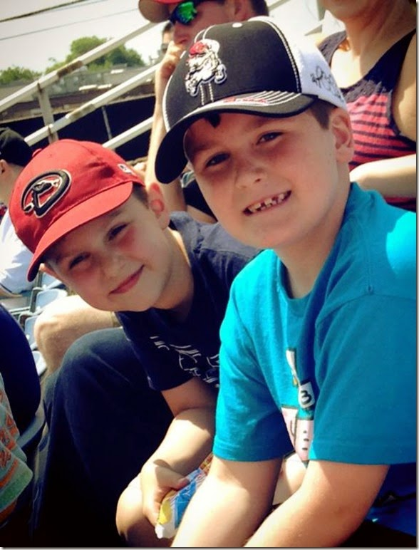 Elijah with friend at Sounds game last day of 2nd grade 5 20 14