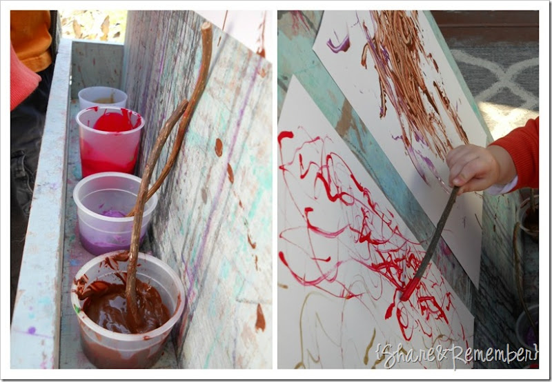 painting with sticks in preschool