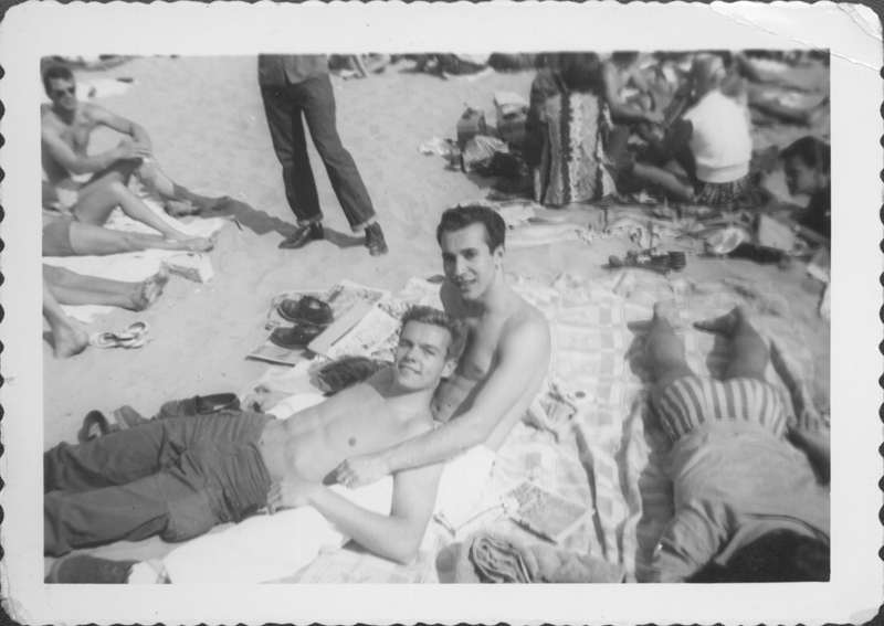 Pat Rocco relaxing on the beach with a friend. Undated.