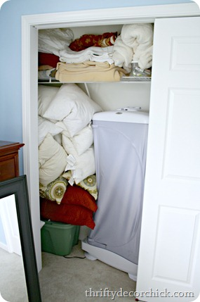 organizing a bedroom closet
