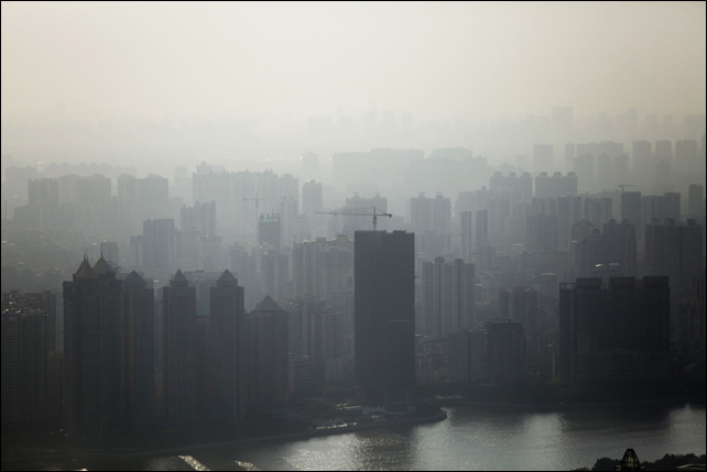 Air pollution in Beijing. Now the world's biggest carbon emitter, China has moved to address the environmental damage that has been a byproduct of its breakneck economic growth and become a leading cause of social unrest. Photo: Brent Lewin / Bloomberg