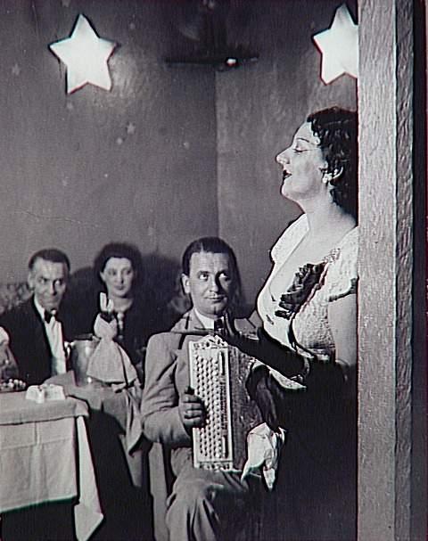Brassaï ~ Kiki singing in Cabaret des Fleurs, c.1932.jpg