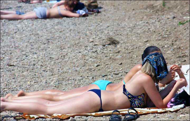 Norilsk - above the Arctic Circle - is known as one of the world's coldest cites, and is built on permafrost. This sunbathing picture was taken around Lake Baikal on 24 July 2013. Photo: The Siberian Times